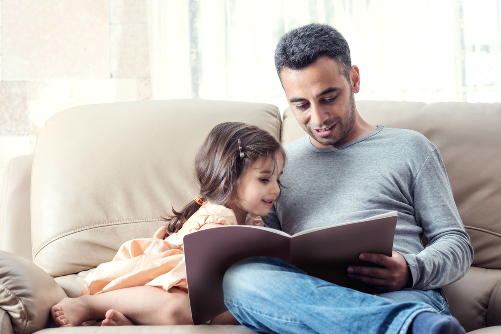 dad reading with his daughter